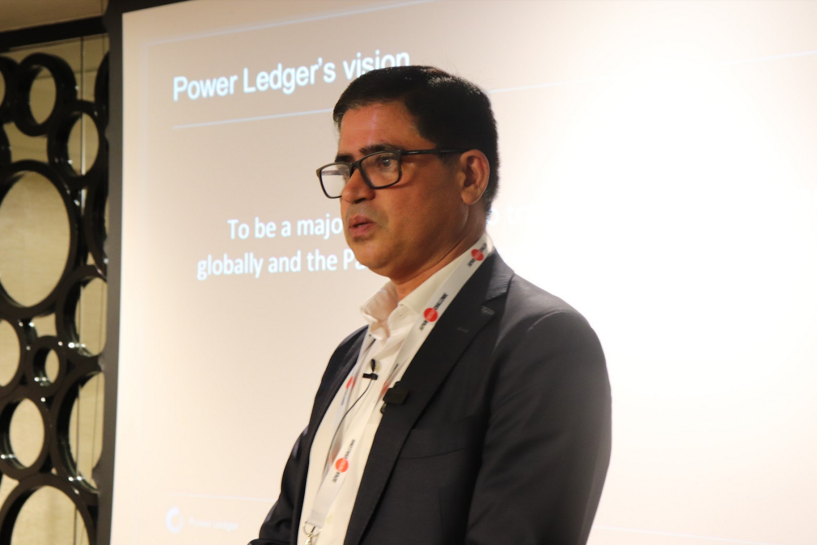 Power Ledger 's Head of Business Development Vinod Tiwari presenting at JEC 2019. Power Ledger designed a blockchain-enabled energy trading platform that can be used to buy and sell electricity in real time.